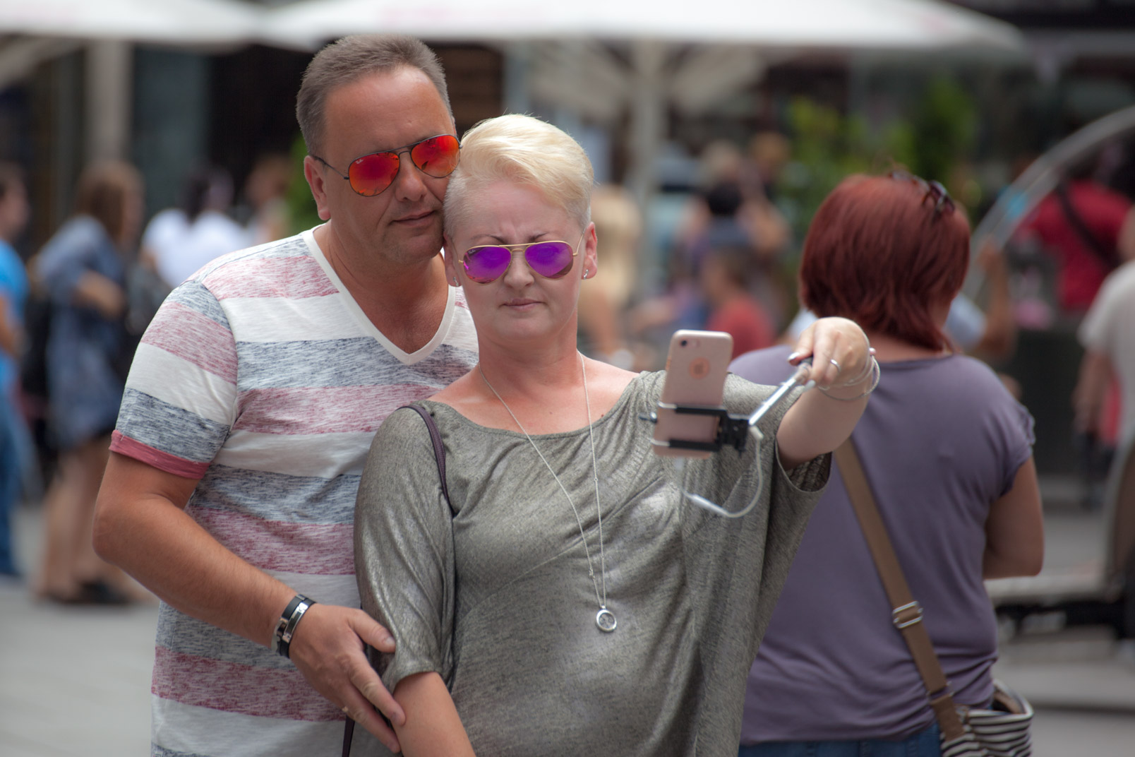 Man taking selfie with woman
